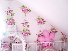 Cath kidston Paris rose wallpaper in the attic bedroom....