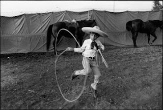 Young man doing a rope trick