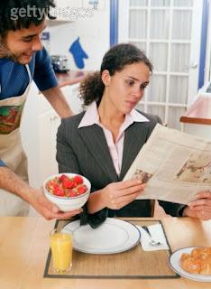 Househusband serving breakfast