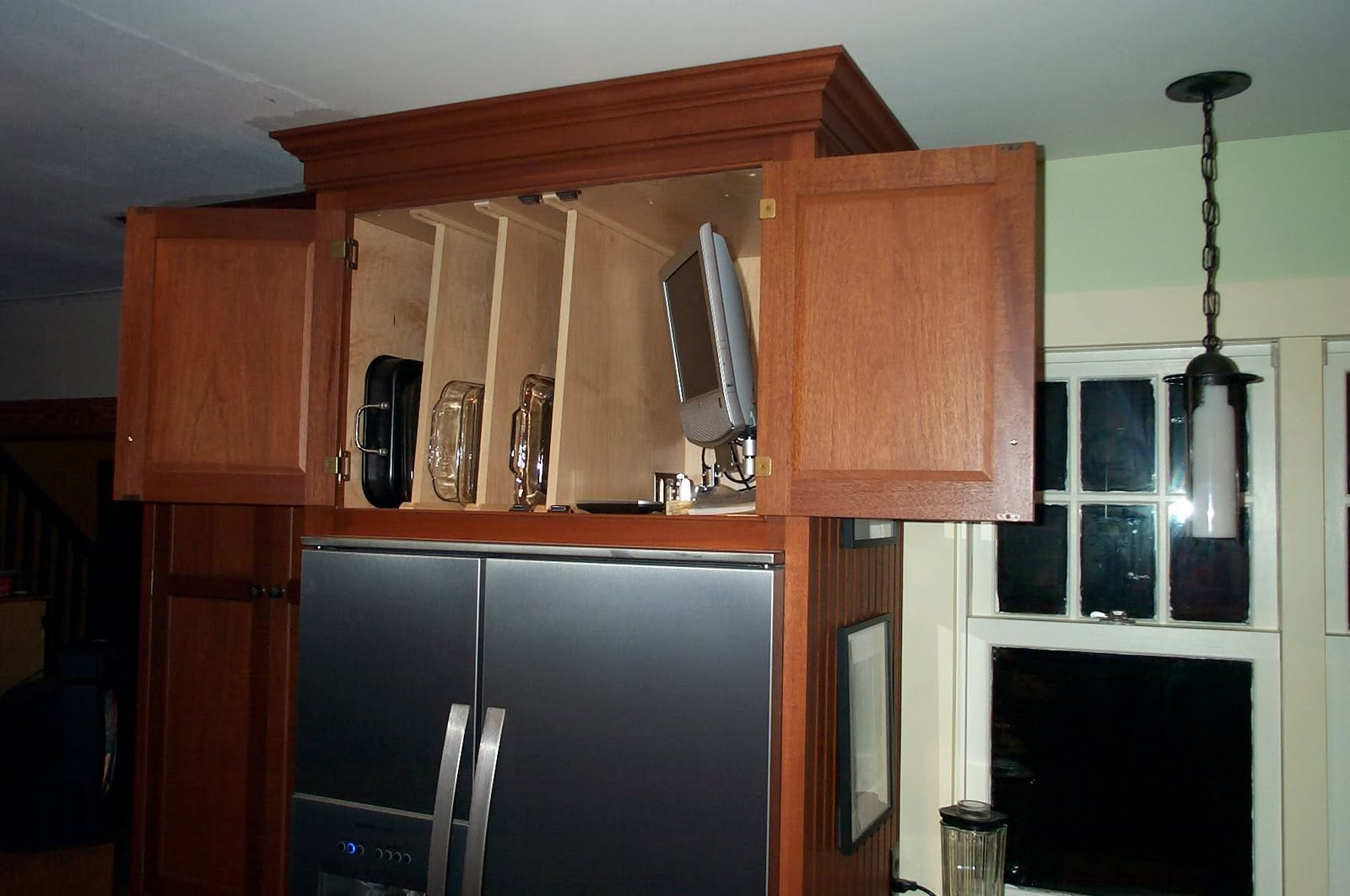 Over the fridge cabinet