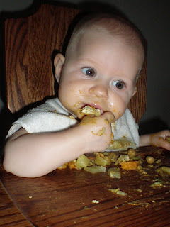 baby eating curry