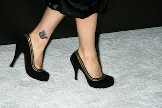 girl Leg Tattoos of small butterflies