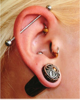 fine art Piercing the ear to the actress