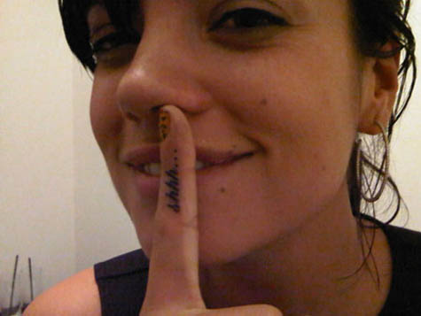 "Also, she has the word ""Shhh"" tattooed on her index finger."