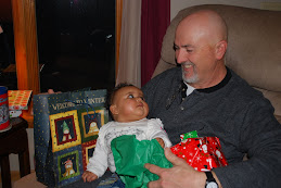 Tysa opening presents with Grandpa