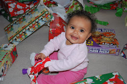 Opening lots of presents, she really liked the one that made noise!!  Go figure...