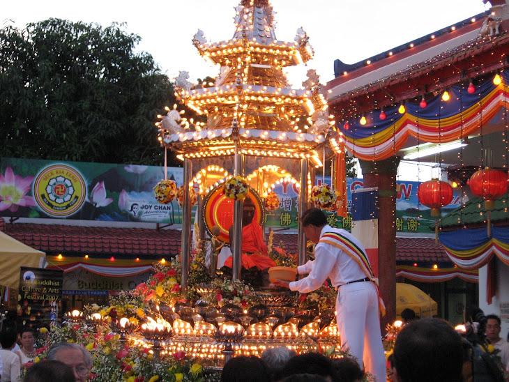 Mr Joy Chan sprinkling bunga rampai round the Buddha chariot