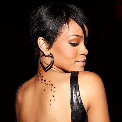 stars tattoos on side. rihanna tattoos on side.