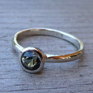 green sunstone ring