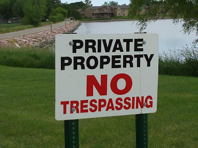 'Private Property: No Trespassing' sign