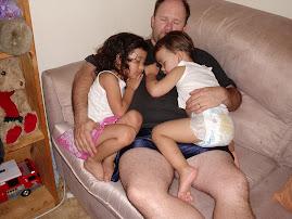 snug as a bug :cuddled warmth of daddy