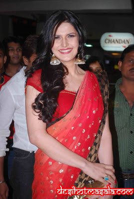 zarin khan red saree