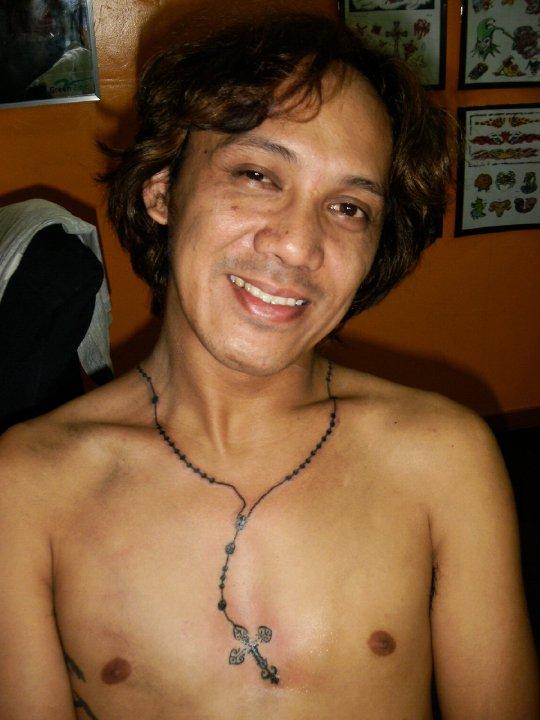 rosaries tattoo designs. Ankle Rosary Tattoo tattoo