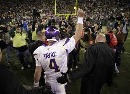 Brett Favre walking off of Lambeau Field