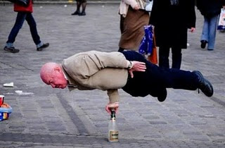 Grandfather Balancing on Bottle Illusion