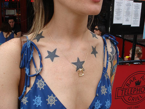 star tattoos behind the ear. red star tattoo