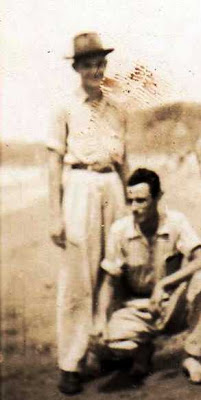 Payito, keeling, with tío Roberto