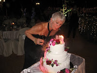 Sandie blowing off the candles