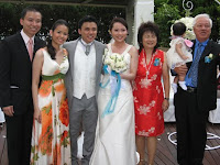 The wedding couple with their family members
