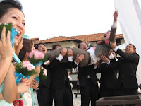 the groom being flung into the air by his friends