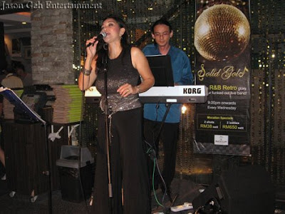 Image of a singer and keyboard player performing live