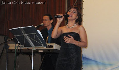 Singer and Keyboardist performing Live at Malaysia SME Congress