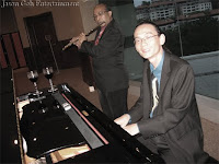 Jason Geh on the piano with his saxophone player