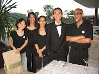 a photo of Jason Geh with members of the organizers