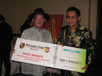 One of the many lucky winners receiving his award