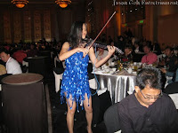 One of the violinist from the Electric Violin Group serenading the guests at IME's event