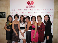 Some of the guests taking a photo with the Wacoal backdrop