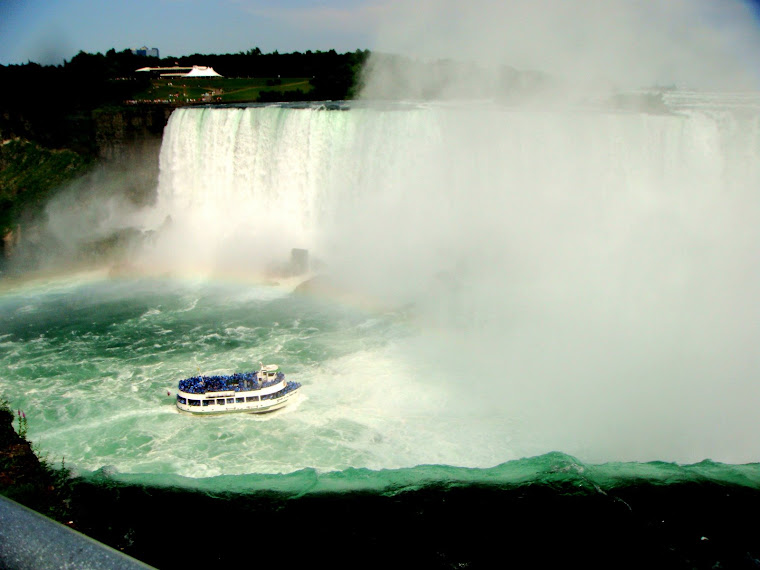 Tour Boat Enters the Mist of the Falls (See rainbow, too.)