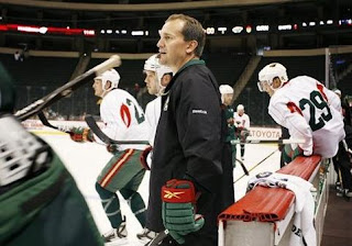 Todd Richards head coach of the Minnesota Wild and his players on the ice
