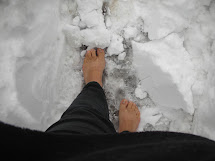 Feet Walking Barefoot in Snow