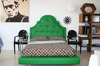 Green bed and couch are just what these spaces needed they bring a