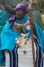 Baba Mutwa with a necklace