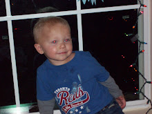Jaxston sitting in the window