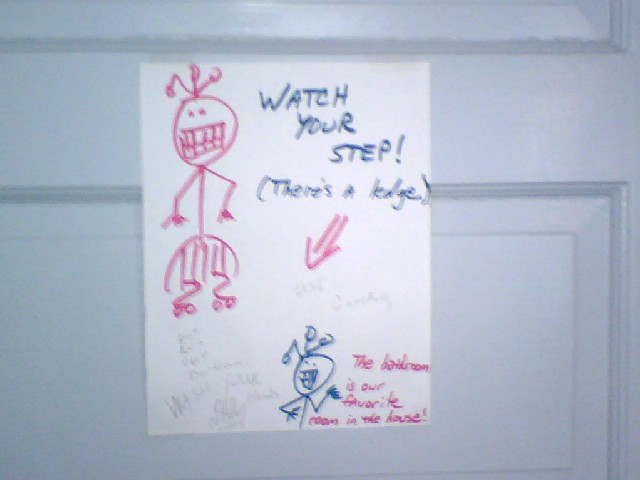 Watch your step! There's a ledge & funny stick people.