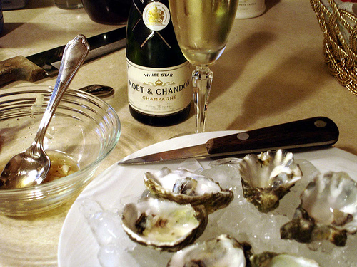 raw oysters, a chilled bottle