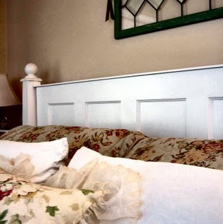 Little Pink Houses had this wonderful idea for a headboard made out