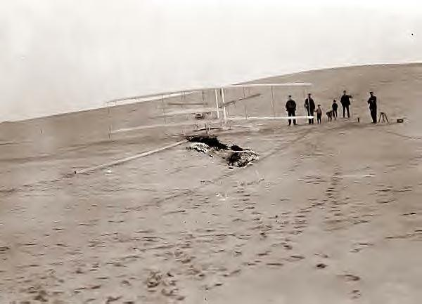 Wright Bros plane on track at Big Kill Devil Hill. 1903