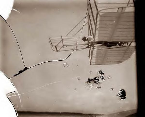 Wilbur Wright piloting plane,1901
