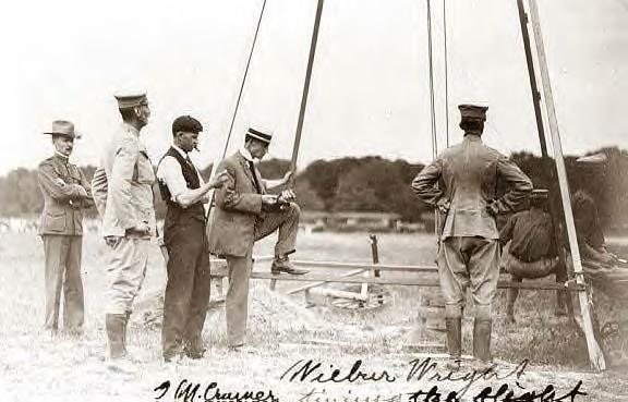 Wilbur Wright & G.M. Cramer, timing the flight, Ft. Myer, Va., 1909