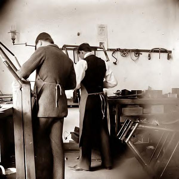 Wilbur Wright in bicycle shop. 1897, Dayton, Ohio