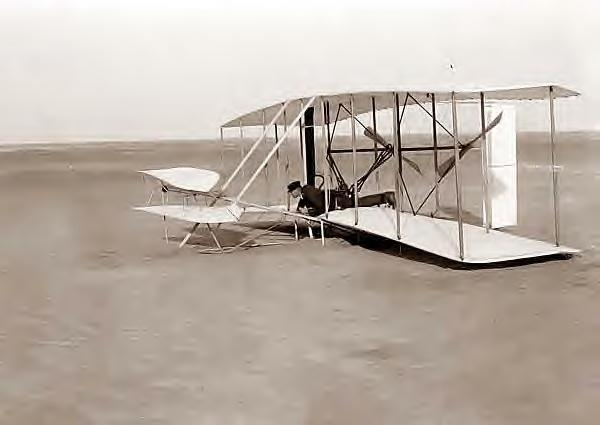 Wright, Wilbur in plane. Kitty Hawk, NC, 12-14-1903