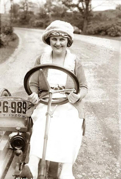 Byron's wife driving his little car the year before in 1920, photo-2
