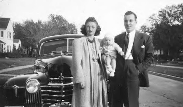 Unknown couple with their car, 1940s