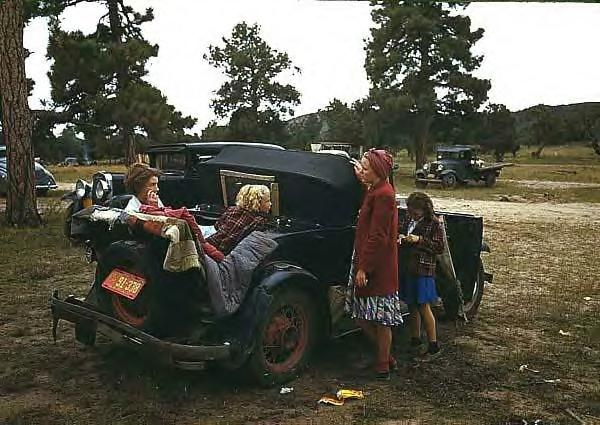 Model A Ford & family at fair, 1940