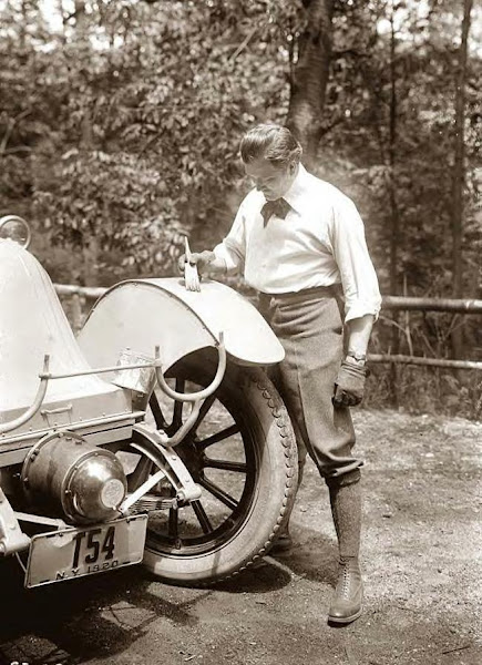 Mr. Thomas of NY painting his car. 1920