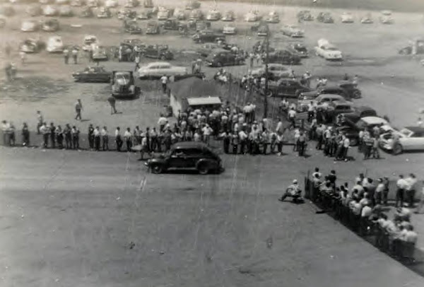 Hotrods come together for a show gathering. Derby Downs in Akron, Ohio, 1958
